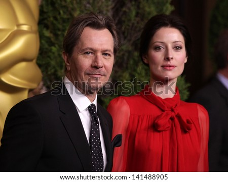 LOS ANGELES - FEB 6:  GARY OLDMAN & GUEST arrives to the 2012 Academy Awards Nominee Luncheon  on Feb 6, 2012 in Beverly Hills, CA - stock photo