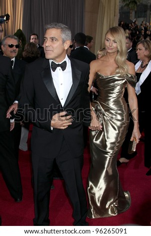 LOS ANGELES - FEB 26:  George Clooney; Stacy Keibler arrives at the 84th Academy Awards at the Hollywood & Highland Center on February 26, 2012 in Los Angeles, CA. - stock photo