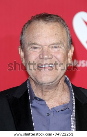 LOS ANGELES - FEB 10:  Glen Campbell arrives at the 2012 MusiCares Gala honoring Paul McCartney at LA Convention Center on February 10, 2012 in Los Angeles, CA - stock photo