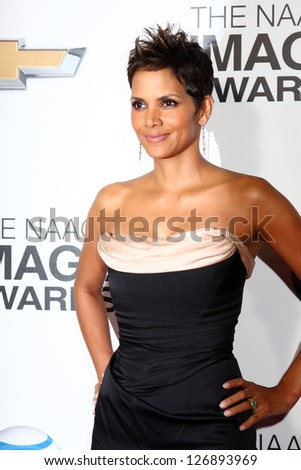 LOS ANGELES - FEB 1:  Halle Berry arrives at the 44th NAACP Image Awards at the Shrine Auditorium on February 1, 2013 in Los Angeles, CA. - stock photo
