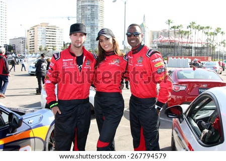 LOS ANGELES - FEB 7:  James Maslow, Donna Feldman, Willie Gault at the Toyota Grand Prix of Long Beach Pro/Celebrity Race Press Day at the Grand Prix Compound on FEB 7, 2015 in Long Beach, CA - stock photo