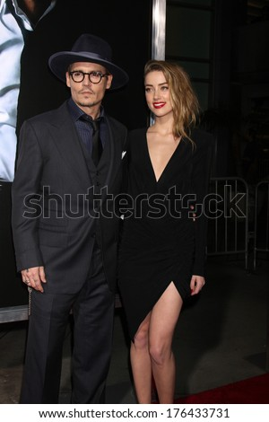"LOS ANGELES - FEB 12:  Johnny Depp, Amber Heard at the ""3 Days to Kill"" LA Premiere at ArcLight Hollywood Theaters on February 12, 2014 in Los Angeles, CA - stock photo"