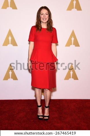 LOS ANGELES - FEB 02:  Julianne Moore arrives to the Oscar Nominee Reception  on February 2, 2015 in Beverly Hills, CA                 - stock photo