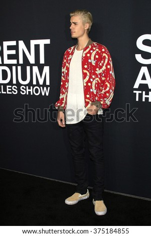 LOS ANGELES - FEB 10: Justin Bieber arriving at the Saint Laurent fashion show at the Hollywood Palladium on February 10, 2016 in Los Angeles, California - stock photo