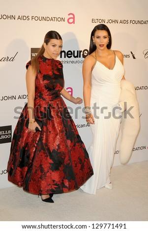 LOS ANGELES - FEB 24:  Kourtney Kardsahian, Kim Kardashian arrive at the Elton John 21st Academy Awards Viewing Party at the West Hollywood Park on February 24, 2013 in West Hollywood, CA - stock photo