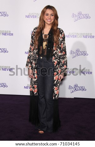 "LOS ANGELES - FEB 09:  MILEY CYRUS arrives to the ""Justin Bieber: Never Say Never"" Los Angeles Premiere  on February 08,2011 in Los Angeles, CA - stock photo"