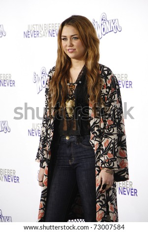 LOS ANGELES - FEB 8:  Miley Cyrus arriving at the Los Angeles premiere of 'Justin Bieber: Never Say Never' at the Nokia Theater L.A.Live in Los Angeles, California. on February 8, 2011. - stock photo