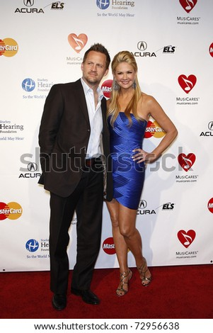 LOS ANGELES - FEB 11: Nancy O'Dell and husband arriving at the Musicares Person of the Year Gala held at the Staples Center in Los Angeles, California on February 11, 2011. - stock photo