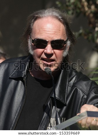 LOS ANGELES - FEB 09:  Neil Young arrives to the Walk of Fame Ceremony for Paul McCartney  on Febraury 09, 2012 in Hollywood, CA                 - stock photo