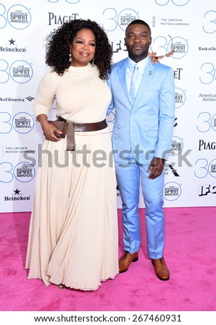 LOS ANGELES - FEB 21:  Oprah Winfrey & David Oleyowo arrives to the 2015 Film Independent Spirit Awards  on February 21, 2015 in Santa Monica, CA                 - stock photo