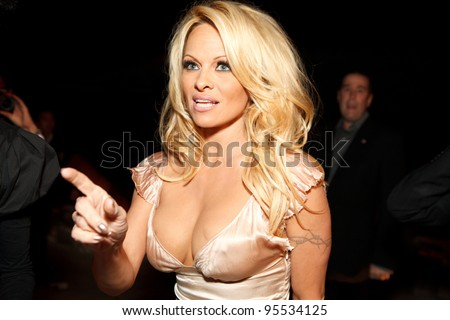 "LOS ANGELES - FEB. 12: Pamela Anderson attends the ""Fame At The Mansion"" 2012 Grammy Aterparty hosted by Sean ""Diddy"" Combs held at the Playboy Mansion. Los Angeles, Feb 12, 2012 - stock photo"