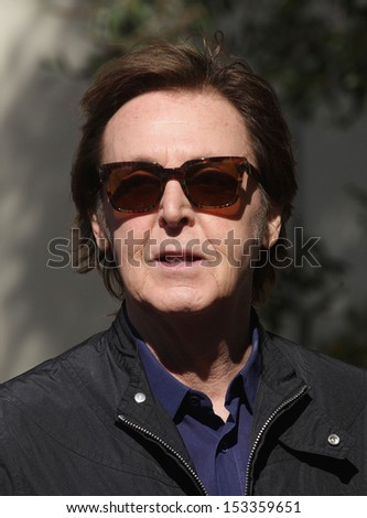 LOS ANGELES - FEB 09:  Paul McCartney arrives to the Walk of Fame Ceremony for Paul McCartney  on Febraury 09, 2012 in Hollywood, CA                 - stock photo