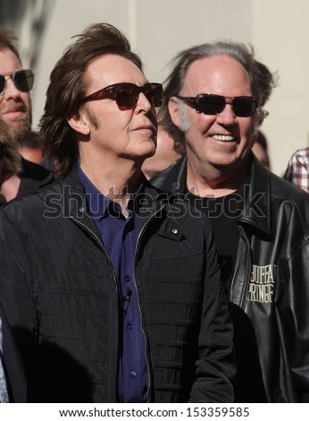 LOS ANGELES - FEB 09:  Paul McCartney & Neil Young arrives to the Walk of Fame Ceremony for Paul McCartney  on Febraury 09, 2012 in Hollywood, CA                 - stock photo