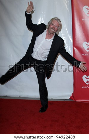 LOS ANGELES - FEB 10: Richard Branson arrives at the 2012 MusiCares Gala honoring Paul McCartney at LA Convention Center on February 10, 2012 in Los Angeles, CA - stock photo