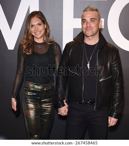 LOS ANGELES - FEB 20:  Robbie Williams & Ayda Field arrives to the Tom Ford Autumn/Winter 2015 Womenswear Collection Presentation  on February 20, 2015 in Hollywood, CA                 - stock photo