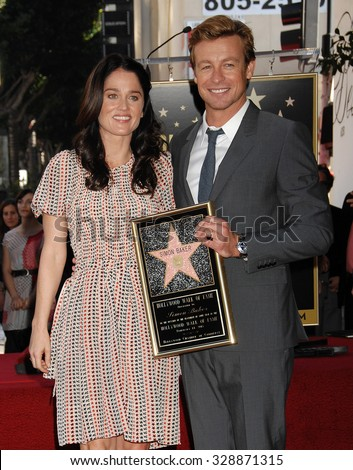 LOS ANGELES - FEB 14 - Robin Tunney and Simon Baker arrives at the Simon Baker  Star On The Hollywood Walk Of Fame Ceremony on February 14, 2013 in Los Angeles, CA              - stock photo