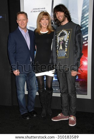 LOS ANGELES - FEB 10:  Steve Fenton, Leeza Gibbons and son Troy Meadows arrives at the ROBOCOP LOS ANGELES PREMIERE  on February 10, 2014 in Hollywood, CA