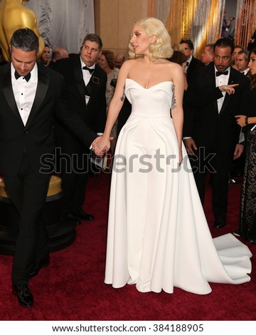LOS ANGELES - FEB 28:  Taylor Kinney, Lady Gaga at the 88th Annual Academy Awards - Arrivals at the Dolby Theater on February 28, 2016 in Los Angeles, CA - stock photo