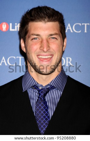 "LOS ANGELES - FEB 13:  Tim Tebow arrives at the ""Act of Valor"" LA Premiere at the ArcLight Theaters on February 13, 2012 in Los Angeles, CA - stock photo"