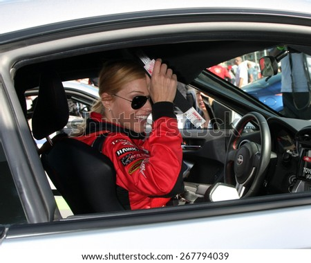 LOS ANGELES - FEB 7:  Tricia Helfer at the Toyota Grand Prix of Long Beach Pro/Celebrity Race Press Day at the Grand Prix Compound on FEB 7, 2015 in Long Beach, CA - stock photo