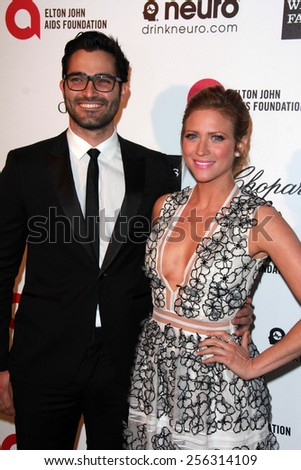 LOS ANGELES - FEB 22:  Tyler Hoechlin, Brittany Snow at the Elton John Oscar Party 2015 at the City Of West Hollywood Park on February 22, 2015 in West Hollywood, CA - stock photo