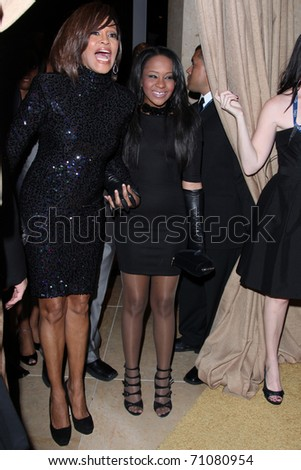 LOS ANGELES - FEB 12:  Whitney Houston; Bobbi Kristina Brown arrives at the 2011 Pre-GRAMMY Gala And Salute To Industry Icons  at Beverly Hilton Hotel on February 12, 2011 in Beverly Hills, CA - stock photo