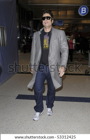 LOS ANGELES - FEBRUARY 2: Actor Benicio Del Torro is seen wearing glasses and a jacket as he makes his way thru LAX (Los Angeles airport). February 2, 2010 in los angeles, california