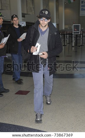 LOS ANGELES - FEBRUARY 8 : Actor Bradley Cooper arrives at LAX on February 8, 2011 in Los Angeles, California