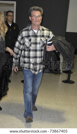 LOS ANGELES - FEBRUARY 8 : Actor Kurt Russell arrives at LAX on February 8, 2011 in Los Angeles, California