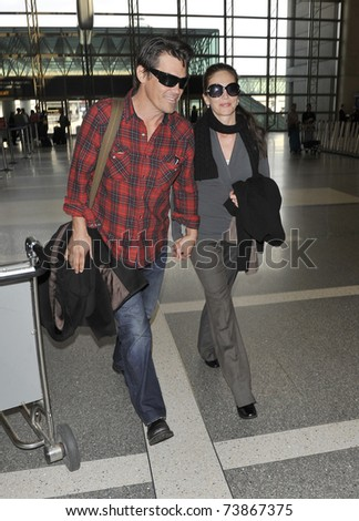 LOS ANGELES - FEBRUARY 8 : Actors Josh Brolin and Diane Ladd arrive at LAX on February 8, 2011 in Los Angeles, California