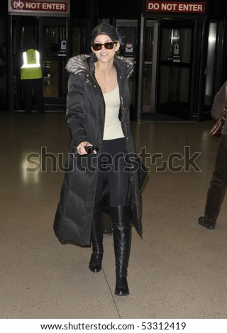 LOS ANGELES FEBRUARY 19 - Actress Anna Lynne McCord is seen in a jacket and sunglasses a she makes her way thru LAX (Los Angeles Airport ) FEBRUARY 19, 2010 - los angeles, california