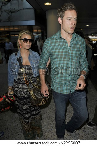 LOS ANGELES-FEBRUARY 14: Actress SInger Jessica Simpson is seen with boyfriend Eric Johnson at LAX. February 14th, 2010 in Los Angeles, California - stock photo