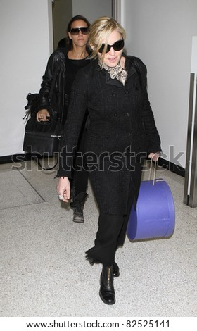 LOS ANGELES-FEBRUARY 26: Singer Madonna is seen at LAX airport. February 26, 2010 in Los Angeles, California - stock photo