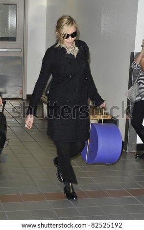 LOS ANGELES-FEBRUARY 26: Singer Madonna is seen at LAX. February 26, 2010 in Los Angeles, California - stock photo