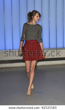 LOS ANGELES-FEBRUARY 22: Singer Taylor Swift is seen at LAX airport. February 22, 2010 in Los Angeles, California - stock photo