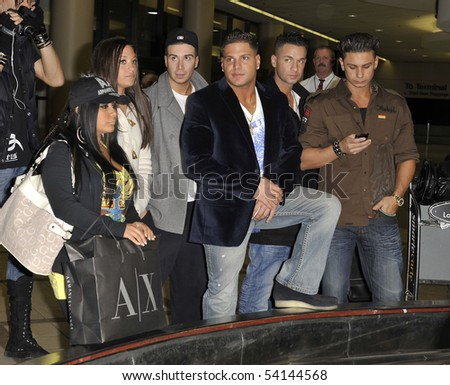 LOS ANGELES - FEBRUARY 23 : Top rated television show Jersey Shore cast mates Snooki, Sammi, Vinny, Ronnie, Mike and DJ Pauly D at LAX February 23, 2010 in Los Angeles, California - stock photo
