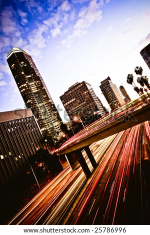 Los Angeles freeway at sunset - stock photo