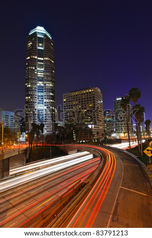 Los Angeles freeways during rush hour at sunset - stock photo