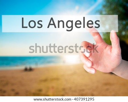 Los Angeles - Hand pressing a button on blurred background concept . Business, technology, internet concept. Stock Photo - stock photo