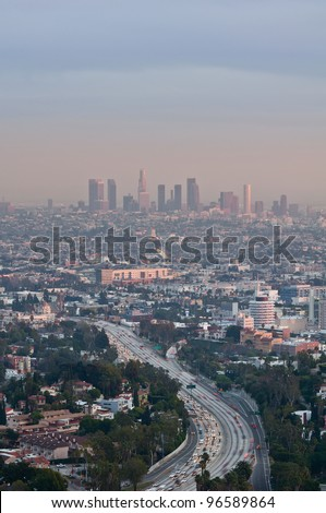 Los Angeles. Image of Los Angeles at twilight with busy freeway in the foreground. - stock photo