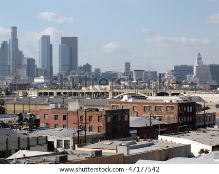 Los Angeles industrial east side with glass tower backdrop. - stock photo