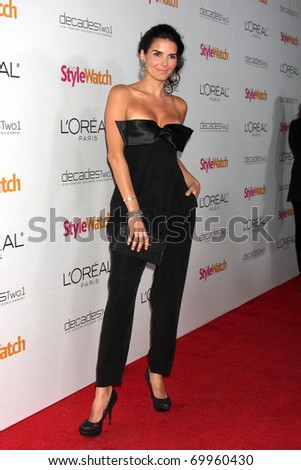 "LOS ANGELES - JAN 27:  Angie Harmon arrives at ""A Night of Red-Carpet Style"" Party hosted by People Stylewatch Magazine at Decades Boutique on January 27, 2011 in Los Angeles, CA"