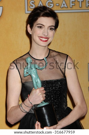 LOS ANGELES - JAN 27 - Anne Hathaway arrives at the 19th Annual Screen Actors Guild Awards Press Room  on January 27, 2013 in Los Angeles, CA              - stock photo