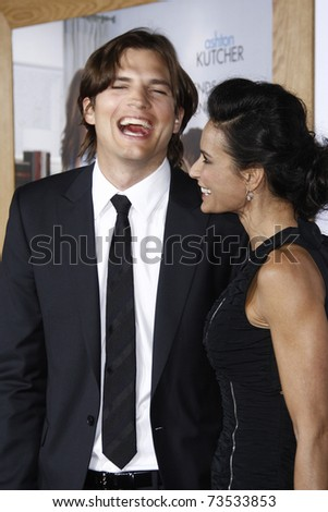 LOS ANGELES - JAN 11:  Ashton Kutcher and Demi Moore arrives at the premiere of 'No Strings Attached' at the Regency Village Theater in Los Angeles, CA on January 11, 2011. - stock photo