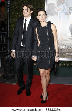 """LOS ANGELES - JAN 11:  Ashton Kutcher, Demi Moore arrives at the """"No Strings"""" Premiere at Regency Village Theater on January 11, 2011 in Westwood, CA - stock photo"""