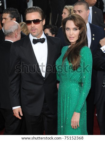 LOS ANGELES - JAN 16:  Brad Pitt & Angelina Jolie arrives to the 68th Annual Golden Globe Awards  on January 16, 2011 in Beverly Hills, CA - stock photo