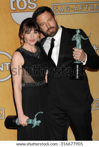 LOS ANGELES - JAN 27 - Clea DuVall and Ben Affleck arrives at the 19th Annual Screen Actors Guild Awards Press Room  on January 27, 2013 in Los Angeles, CA              - stock photo