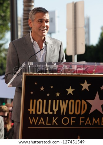 LOS ANGELES - JAN 12:  George Clooney arriving to Walk of Fame Ceremony for John Wells  on January 12, 2012 in Hollywood, CA - stock photo