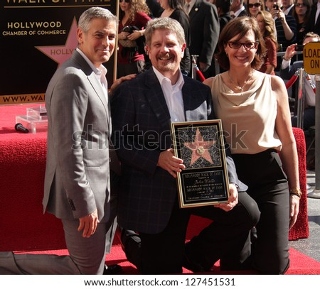 LOS ANGELES - JAN 12:  George Clooney, John Wells & Allison Janney arriving to Walk of Fame Ceremony for John Wells  on January 12, 2012 in Hollywood, CA - stock photo