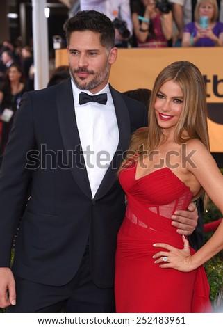 LOS ANGELES - JAN 25:  Joe Manganiello & Sofia Vergara arrives to the 21st Annual Screen Actors Guild Awards  on January 25, 2015 in Los Angeles, CA                 - stock photo